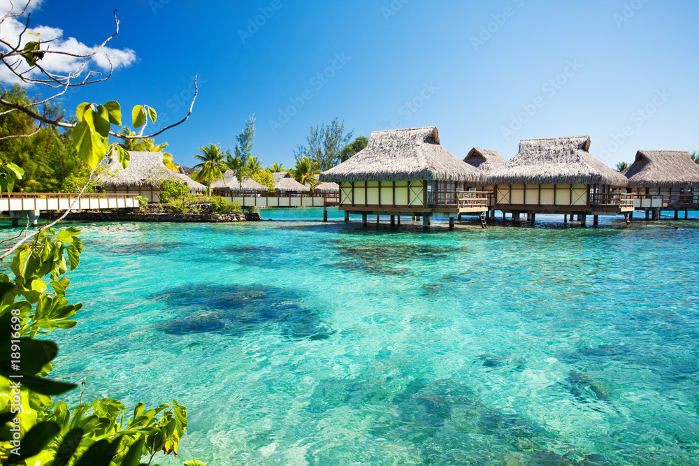 Fototapeta Over water bungalows with over amazing lagoon