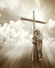 Fototapeta jesus holding a cross