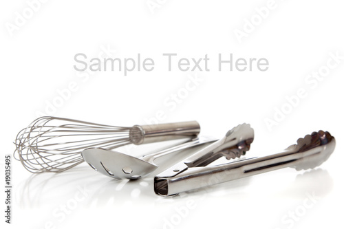 Fotografia, Obraz Silver kitchen utensils on white with copy space