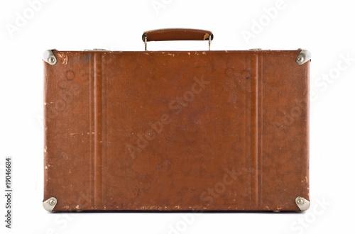 Fotografia Traveling - old-fashioned suitcase isolated