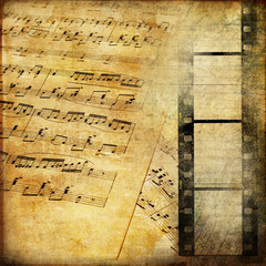 Fototapeta vintage background with musical pages and filmstrip