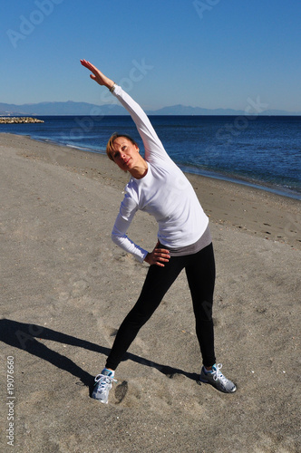 Blond woman stretching arms Wallpaper Mural