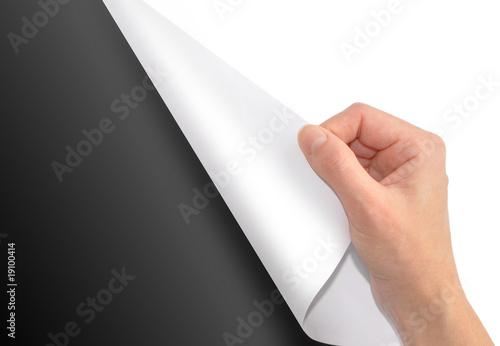 Fotografía  White Page Turning on Black Background