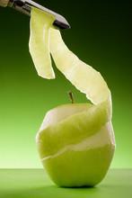 Peeled Green Apple And Peeler