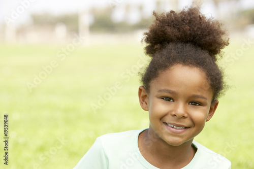 Valokuva  Portrait Of Young Girl Sitting In Park