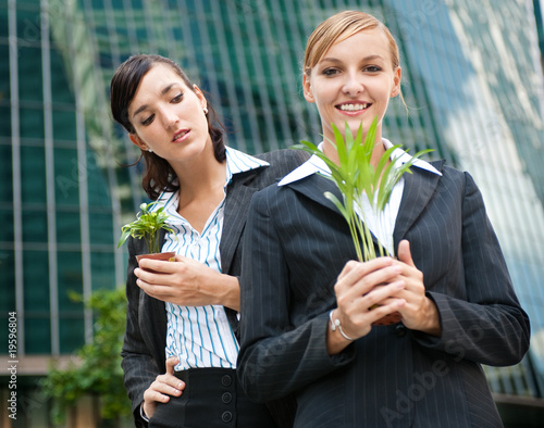 Businesswomen with Plants Canvas Print