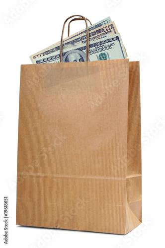 Fotografía  Shopping bag on white with dollar money