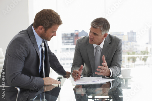 Two men at a meeting