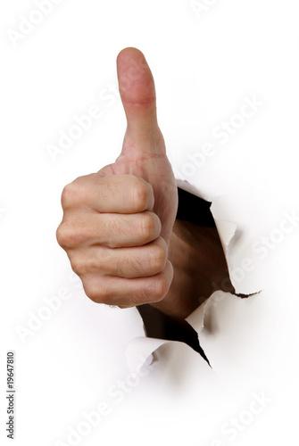 Valokuva  Hand mit Daumen hoch durchbricht Wand