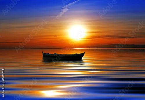 sol mar y barco
