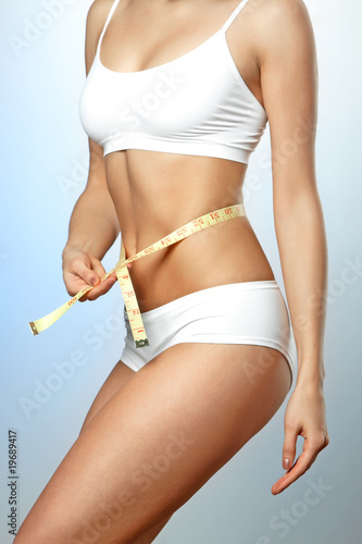 Fotografía  Fitness body with a tape