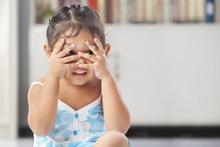Little Girl Playing Peekaboo