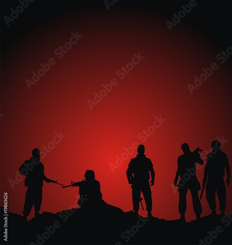 Foto op Canvas Militair soldiers silhouettes standing against sunset background