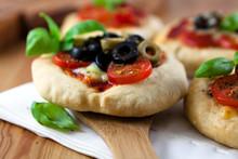 Close Up Of Mini Pizzas