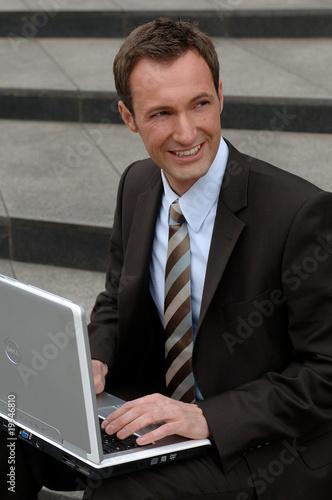 Fototapety, obrazy: Geschäftsmann bei der Arbeit