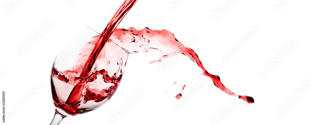 Red wine being poured into a wineglass