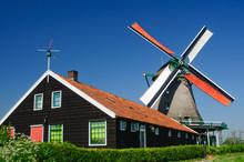 A Traditional Dutch Windmill In The Quaint Village