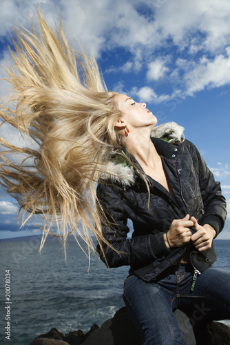 Fotografering Young Woman Tossing Blond Hair