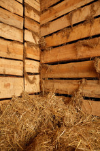 Interior Of Village Building. Lot Of Hay In Barn Of Rough Planks