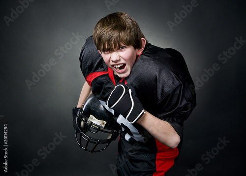 Photo Victorious boy after winning american football game