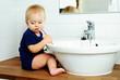 cute year-old boy brushes teeth