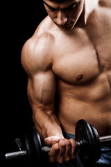 Fototapeta Powerful muscular man lifting weights