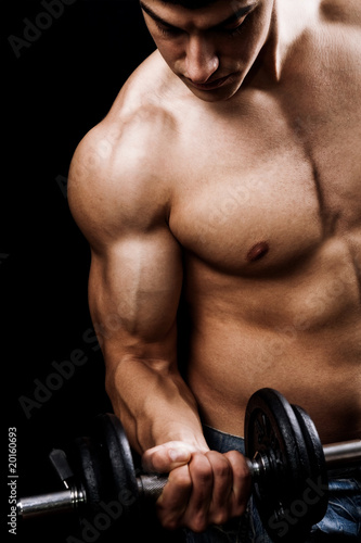 Powerful muscular man lifting weights - 20160693