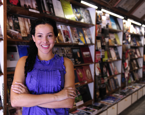 Photographie  happy owner of a bookstore