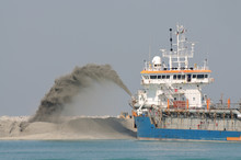 Dredge Ship Pipe Pushing Sand To Create New Land