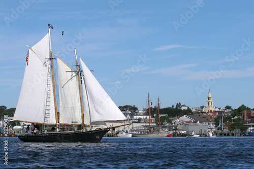 Fotografie, Obraz  Schooner sails over the ocean waves in the bay near a harbor
