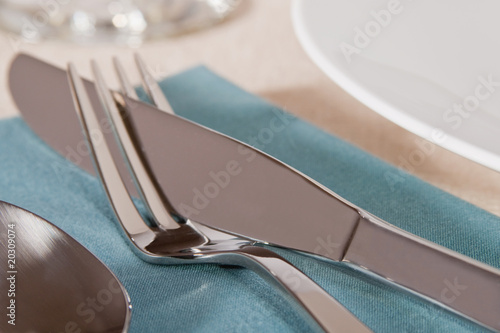 Elegant placesetting of knife and fork on blue Tablou Canvas