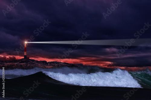 Foto op Aluminium Vuurtoren Lighthouse on the rocks in storm ocean