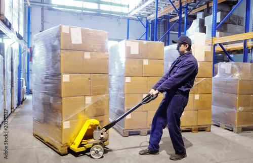 Fotografie, Obraz  worker with stacker at warehouse