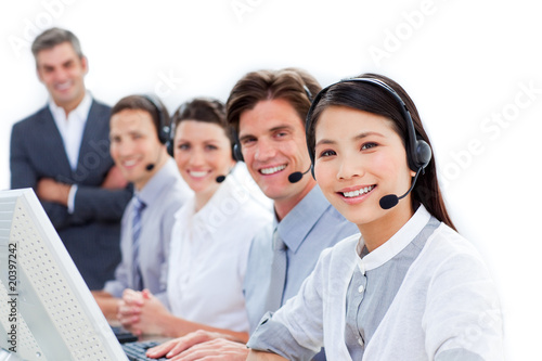 Smiling Business Team Talking On Headset Buy This Stock