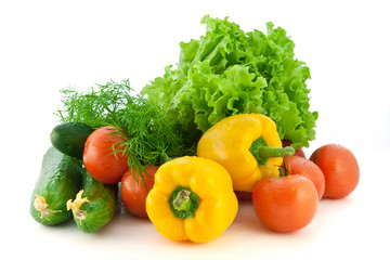 Fresh vegetables for salad on a white background