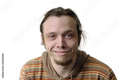 Photo doof blickender junger Mann