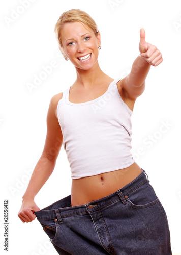 Fotografie, Obraz  Frau zeigt Top nach abnehmen