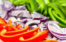 Closeup Of Chopped Peppers And Onion