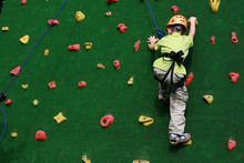 Child On A Climbing Wall