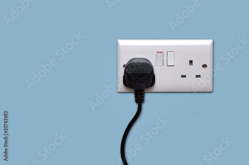 Fotografía  Double power socket and single plug switched on