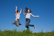 Girl and boy jumping, running outdoor