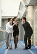 group of three persons success on the corridor in office space