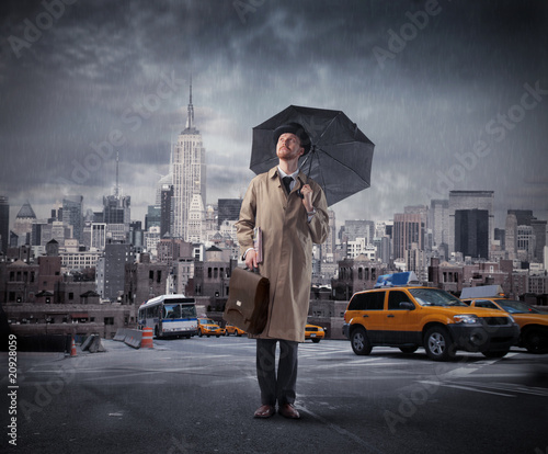 Photo  businessman with umbrella