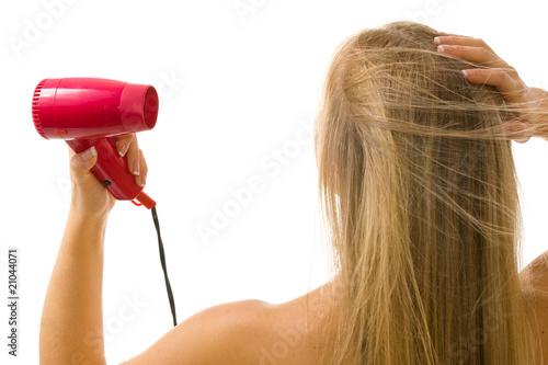 Obraz Blondynka susząca włosy - fototapety do salonu
