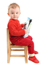 Baby Sitting On Chair Reading ...