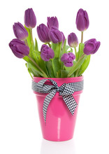 A Bunch Of Purple Tulips In A Pink Vase With A Checkered Ribbon