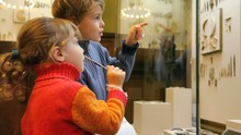 Boy And Girl With Pencil And Notebook In Museum Of History