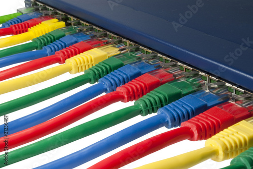 Photographie  Multi colored ethernet network cables connected to a router