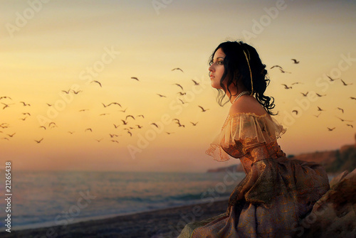 Photo  The girl in dress on beach