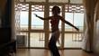sexy young caucasian woman dancing belly dance indoor